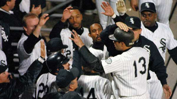 Chicago White Sox shortstop Ozzie Guillen is greeted by teammates in the dugout after scoring on a Tim Raines single during the fourth inning, Tuesday, Oct. 5, 1993, at Comiskey Park in Chicago in Game 1 of the American League Championship.  <span class=meta>(AP Photo&#47;Mark Elias)</span>